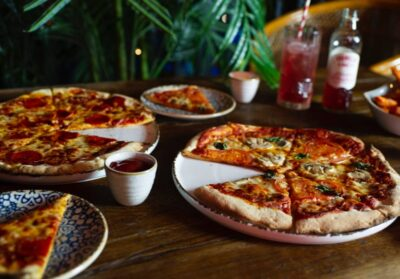 Pizzas and Sides on a table